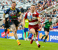 Wigan Warriors' Liam Marshall beats Warrington Wolves' Josh Charnley on the way to scoring his side's fifth try<br /> <br /> Photographer Alex Dodd/CameraSport<br /> <br /> Betfred Super League Round 15 - Magic Weekend - Wigan Warriors v Warrington Wolves - Saturday 19th May 2018 - St James' Park - Newcastle<br /> <br /> World Copyright &copy; 2018 CameraSport. All rights reserved. 43 Linden Ave. Countesthorpe. Leicester. England. LE8 5PG - Tel: +44 (0) 116 277 4147 - admin@camerasport.com - www.camerasport.com