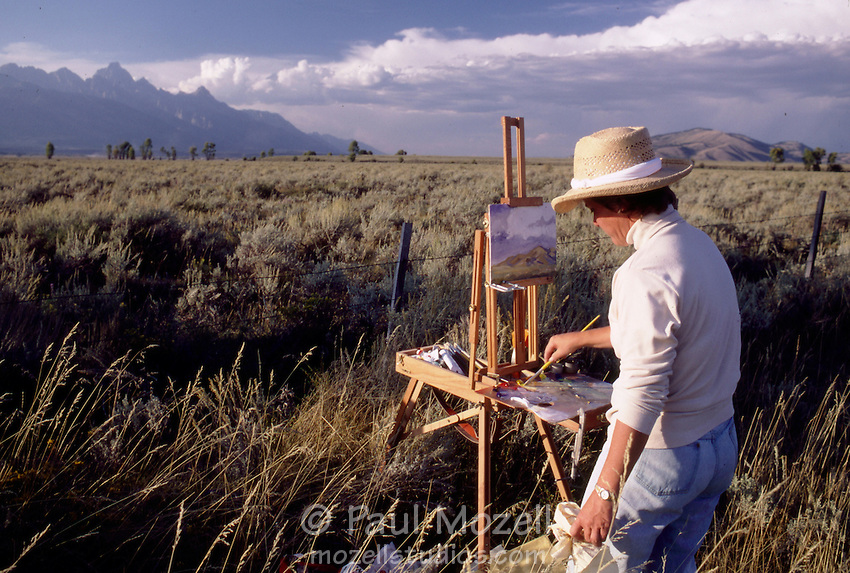 An artist paints The Grand Teton in late afternoon light