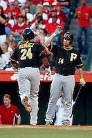 Pedro Alvarez #24 of the Pittsburgh Pirates is greeted by teammate Gabe Sanchez #14 after hitting a home run during a game against the Los Angeles Angels at Angel Stadium on June 21, 2013 in Anaheim, California. (Larry Goren/Four Seam Images)