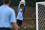 24 September 2009: North Carolina's Hannah Daly takes some practice balls from assistant coach Chris Ducar (foreground). The University of North Carolina Tar Heels defeated the Duke University Blue Devils 2-1 in sudden victory overtime at Fetzer Field in Chapel Hill, North Carolina in an NCAA Division I Women's college soccer game.