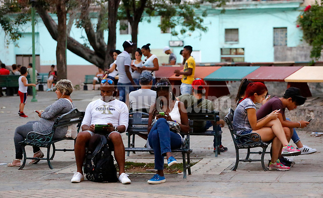 People surf the internet at a public wifi hotspot in Havana, Cuba, Monday, Jan. 16, 2017.