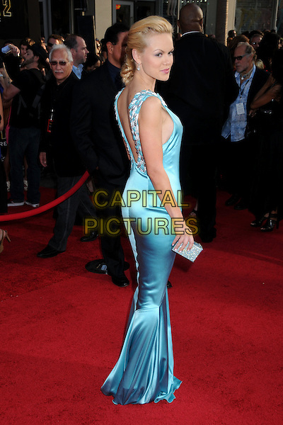 """ANYA MONZIKOVA .""""Iron Man 2"""" World Premiere held at the El Capitan Theatre, Hollywood, California, USA, 26th April 2010..arrivals full length side back rear behind over shoulder blue turquoise silk satin long maxi dress fishtail silver clutch bag .CAP/ADM/BP.©Byron Purvis/AdMedia/Capital Pictures."""