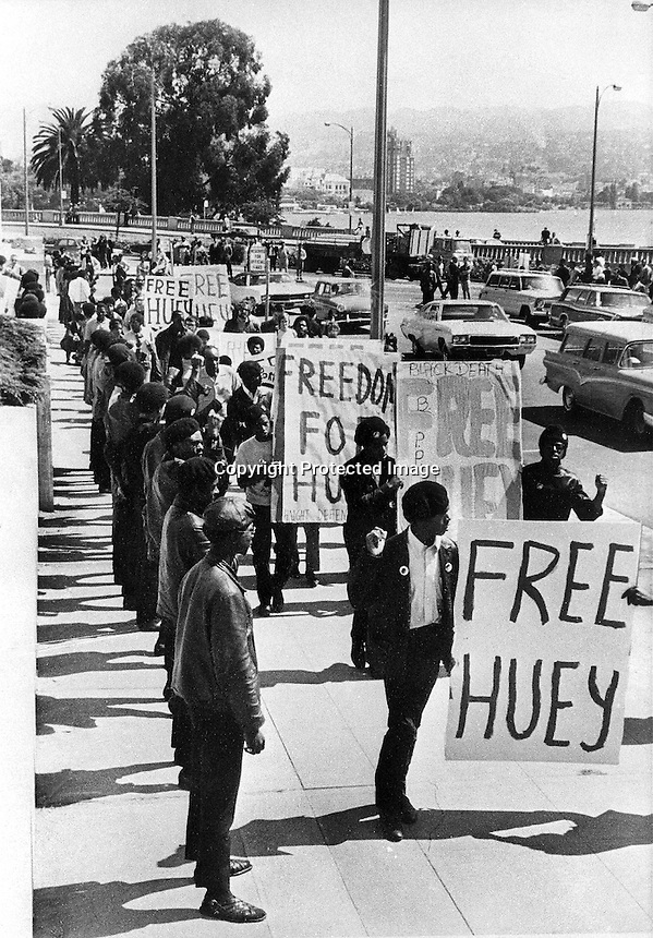 "Black Panthers line up outside the Alameda County Courthouse for a ""Free Huey"" protest. (1968 @copyright photo/Ron Riesterer)"