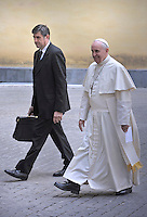 Pope Francis  pope's assistant Sandro Mariotti during a meeting Spain's King Juan Carlos  and Queen Sofia  at the end of their private audience at the Vatican. on April 28, 2014