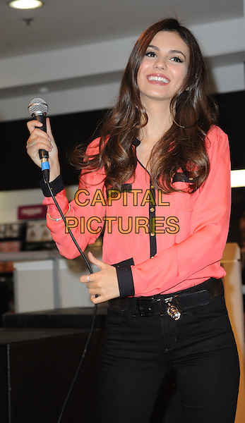 Victoria Justice.Fans of the hit Nickelodeon TV series VicTORious get the chance to meet the star, Victoria Justice, in person, when she visits HMV's flagship Oxford Street store in London's West End to sign copies of the VicTORious album, DVD & Game. .22nd February 2012.half length black pink blouse microphone jeans denim.CAP/WIZ.© Wizard/Capital Pictures.