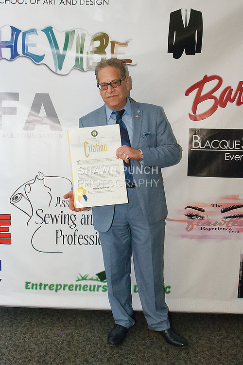 Jeffery Bernstein receives a Citation from the Brooklyn Borough President's Office, during the Teachers Rock The Runway fashion show presented by the United Federation of Teachers, at 52 Broadway in New York City, on May 31st 2018.