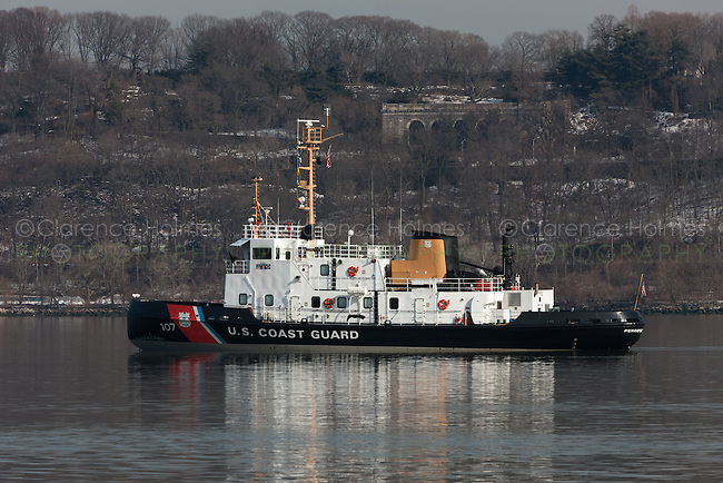 US Coast Guard Cutter Penobscot Bay, a small icebreaker, sits at anchor on the Hudson River just north of the George Washington Bridge.  The WTGB class cutter, homeported at Bayonne Ocean Terminal in Bayonne, New Jersey, helps keep the Hudson clear of ice in winter.