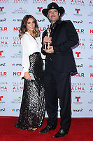 PASADENA, CA - SEPTEMBER 27: Actress Jessica Alba and Director Robert Rodriguez pose in the press room during the 2013 NCLR ALMA Awards held at Pasadena Civic Auditorium on September 27, 2013 in Pasadena, California. (Photo by Xavier Collin/Celebrity Monitor)