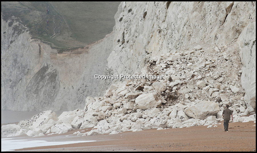 BNPS.co.uk (01202 558833).Pic: RachelAdams/BNPS..Recent fall near Lulworth Cove in Dorset...Unprecedented weather takes its toll on Britains crumbling coast...The South West coast path is under threat after a series of landslips and cliff falls have left the Jurassic coast World Heritage site with some dinosaur sized clefts and chasm's...Walkers could soon face being deprived of some of the country's most beautiful views after the prolonged cold and wet winter has led to a series of devastating landslides...Since last April heavy rain has caused several landslides on large sections of the Jurassic Coast in Dorset, forcing authorities to close parts of the popular coastal path...Last July holidaymaker Charlotte Blackman, 22, was killed when a landslide caused 400 tons of rocks to fall on her from above as she walked along a beach at Burton Bradstock...And a recent landslide at popular tourist spot Durdle Door means sections of the nearby coastal path overlooking the famous sight have been closed due to safety concerns...On that occasion around 400 tons of chalk rock covered the beach below after collapsing from the 90-million-years-old cliff...Fresh cliff falls and cracks appeared along the coast on Sunday as coastguards issued a warning saying the pathway is falling away.