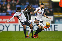 Bolton Wanderers' Mark Little and Dorian Dervite combine to tackle Fulham's Ryan Sessegnon <br /> <br /> Photographer Andrew Kearns/CameraSport<br /> <br /> The EFL Sky Bet Championship - Bolton Wanderers v Fulham - Saturday 10th February 2018 - Macron Stadium - Bolton<br /> <br /> World Copyright &copy; 2018 CameraSport. All rights reserved. 43 Linden Ave. Countesthorpe. Leicester. England. LE8 5PG - Tel: +44 (0) 116 277 4147 - admin@camerasport.com - www.camerasport.com