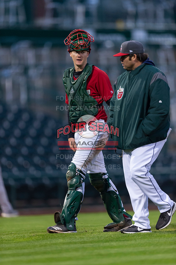 Fort Wayne TinCaps catcher Blake Hunt (12) talks to pitching coach Matt Williams (29) during a Midwest League game against the Fort Wayne TinCaps at Parkview Field on April 30, 2019 in Fort Wayne, Indiana. Kane County defeated Fort Wayne 7-4. (Zachary Lucy/Four Seam Images)