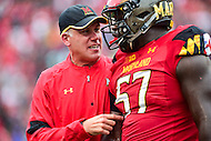 College Park, MD - OCT 1, 2016: Maryland Terrapins head coach DJ Durkin is fired up speaking to Maryland Terrapins defensive lineman Kingsley Opara (57) after his big sack on Purdue Boilermakers quarterback during game at Capital One Field at Maryland Stadium in College Park, MD. The Terps got the win 50-7 over visiting Purdue. (Photo by Phil Peters/Media Images International)