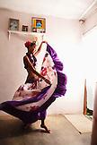 MAURITIUS, Surinam, a young woman Sega dancer, Cyndia Venratachullum, dances in her home to the rhythm of the Sega music