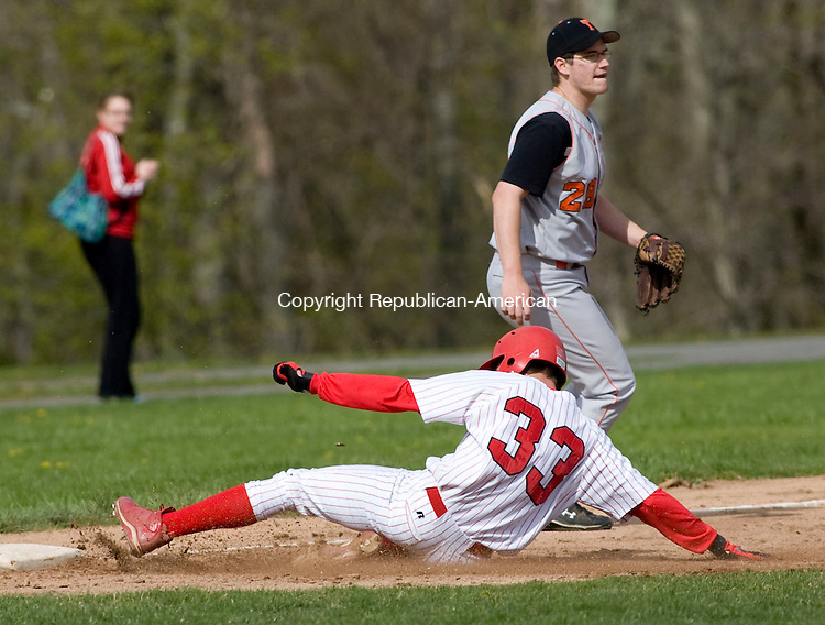 LITCHFIELD, CT - 28 APRIL 2010 -042810JT09-<br /> Wamogo's Lucas Fraher steals third base as he slides past Terryville's Chris Roy during Wednesday's game at Wamogo. <br /> Josalee Thrift Republican-American