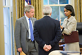 Washington, D.C. - June 7, 2006 -- United States President George W. Bush talks with Secretary of State Condoleezza Rice and White House Chief of Staff Joshua Bolten in the Oval Office after receiving news of terrorist Abu Musab al-Zarqawi death in Iraq at 4:49 p.m. Wednesday, June 7, 2006. <br /> Mandatory Credit: Eric Draper - White House via CNP