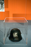 DEU, Deutschland, Germany, Berlin, 15.10.2010.Helmet at the exhibition Hitler and the Germans Nation and Crime, Hitler und die Deutschen Volksgemeinschaft und Verbrechen, at the Deutsche Historische Museum, German Historical Museum, in Berlin, Germany. The new exhibition opening in Berlin has Adolf Hitler as its focus for the first time. It seeks to answer the question of why so many Germans chose to follow Hitler and his fascist ideology and so devotedly despite the horrors of World War II and the Holocaust. Exhibition hitler and the Germans. Exhibition, culture, cultural, visitor, visitors,  work of art, art, europe, exhibitions, exposition, expositions, geman, show, German, Germany, Europe, 2010, Event, Politics, Adolf Hitler, Fascism, Nazism, Arts Culture and Entertainment, display..[(c) Stefan Boness/Ipon - Veroeffentlichung nur gegen Honorar (zuzuegl. MwSt.), Namensnennung und Beleg; Kto.: 940165350, Bln. Spk., BLZ 100 500 00; Claudiusstr. 6, 10557 Bln, Phone: ++49-(0)30-3934318, www.iponphoto.com, e-mail: boness@iponphoto.com; No Model Release. Vereinbarungen ueber Model Release / Abtretung von Persoenlichkeitsrechten der abgebildeten Person/Personen liegen nicht vor.]