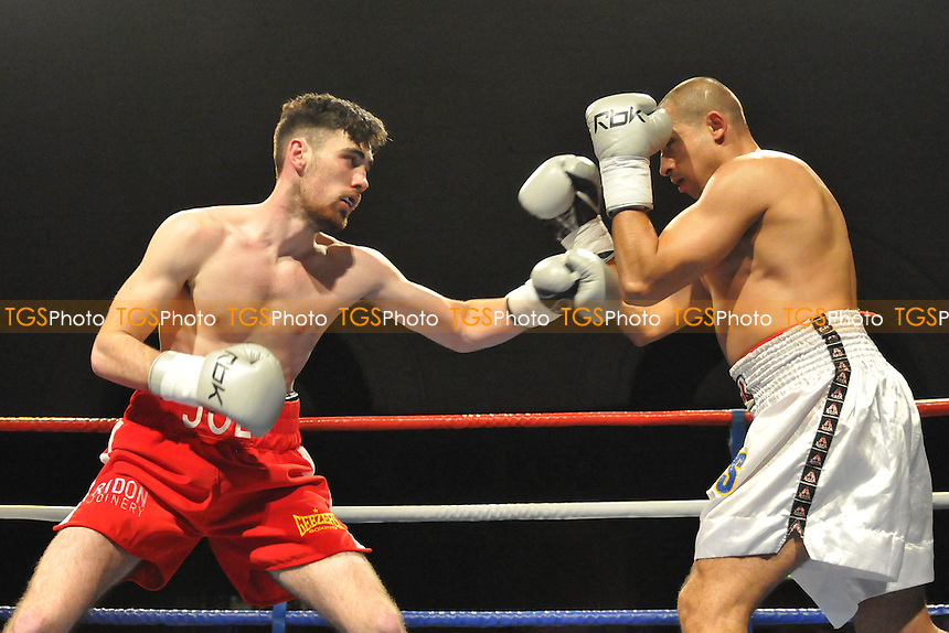 Joe Pigford defeats Janko Marinov in a boxing contest at the Guildhall, Southampton, Hampshire - 22/03/14 - MANDATORY CREDIT: Philip Sharkey/TGSPHOTO - Self billing applies where appropriate - 0845 094 6026 - contact@tgsphoto.co.uk - NO UNPAID USE