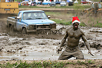A muddy men with a Christmas hat at the 2005 edition of the Victoria Day week-end at Trudeau Park in Tweed, Ontario
