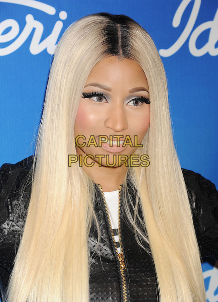 "Nicki Minaj.in the press room at FOX's ""American Idol"" Grand Finale at Nokia Theatre L.A. Live in Los Angeles, California, USA, May 16, 2013..portrait headshot make-up beauty roots black jacket white makeup hair dyed roots wig false lashes eyelashes .CAP/ROT/TM.©Tony Michaels/Roth Stock/Capital Pictures"