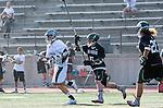 La Canada Flintridge, CA 03/16/13 - Trent Schulte (Coronado #6) and Will Montero (De La Salle #22) in action during the De La Salle vs Coronado lacrosse game at St Francis High School.  De La Salle defeated Coronado 8-5.