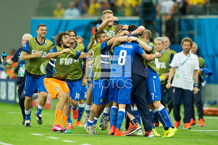 Claudio Marchisio of Italy celebrates scoring a goal with Daniele De Rossi and the Italian bench after making it 0-1