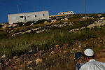 Erez Liberman, a settler, talks to his son at the unauthorized Israeli outpost of Chavat Alumot, West Bank.