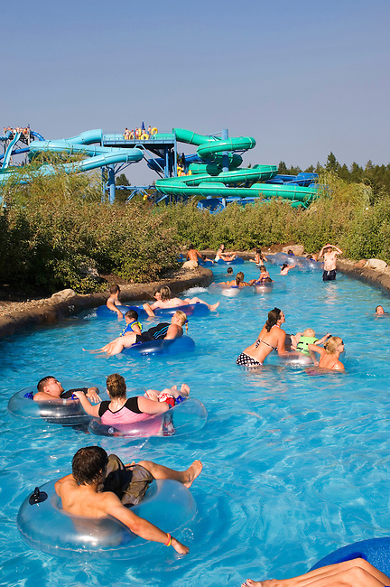 USA, IDAHO, NEAR COEUR D'ALENE, SILVERWOOD THEME PARK, BOULDER BEACH WATER PARK, PEOPLE FLOATING IN FLOAT TUBES