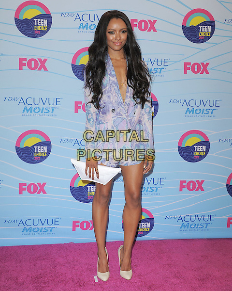 Kat Graham.Teen Choice Awards 2012 - Press Room held at Gibson Amphitheatre, Universal City, California, USA..July 22nd, 2012.full length white clutch bag blue print dress blazer.CAP/RKE/DVS.©DVS/RockinExposures/Capital Pictures.
