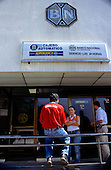 San Isidro, Costa Rica. People outside the Banco Nacional with cash point sign.