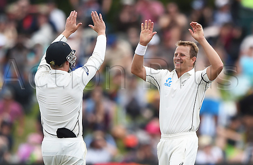 22.02.2016. Christchurch, New Zealand.  Neil Wagner is congratulated by Henry Nicholls after taking 6 wickets on Day 3 of the 2nd test match. New Zealand Black Caps versus Australia. Hagley Oval in Christchurch, New Zealand. Monday 22 February 2016.