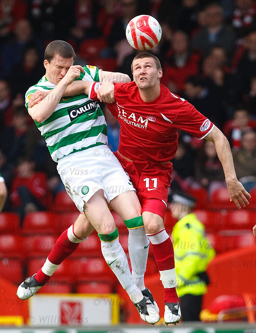 Tommy Wright clatters into Gary Caldwell