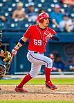 28 February 2017: Washington Nationals catcher Jose Lobaton hits an RBI single in the bottom of the 8th inning of the Spring Training inaugural game against the Houston Astros at the Ballpark of the Palm Beaches in West Palm Beach, Florida. The Nationals defeated the Astros 4-3 in Grapefruit League play. Mandatory Credit: Ed Wolfstein Photo *** RAW (NEF) Image File Available ***