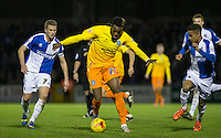 Gozie Ugwu of Wycombe Wanderers heads past Lee Mansell (left) of Bristol Rovers & Paris Cowan-Hall of Bristol Rovers during the Sky Bet League 2 rearranged match between Bristol Rovers and Wycombe Wanderers at the Memorial Stadium, Bristol, England on 1 December 2015. Photo by Andy Rowland.