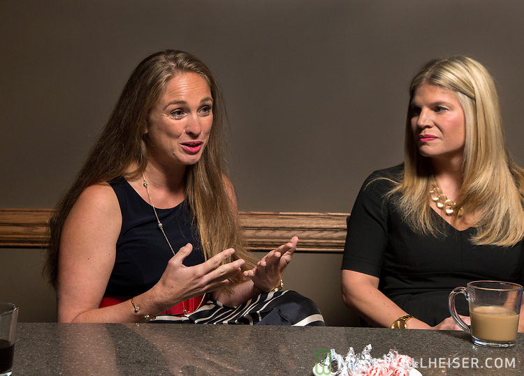 Lobbyist Monica Rodriguez, left and Andrea Reilly participate during a Florida Women Lobbyist round table at the Blue Halo Restaurant in Tallahassee, Florida.