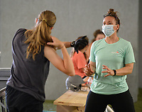 "Megan Turk (right), owner of The Warehouse in Fayetteville, helps Austynn Caudle, 15, of West Fork with her swing mechanics Tuesday, June 23, 2020, during a workout session at the softball-only training facility in Fayetteville. The business opened in February, just before the current coronavirus pandemic struck. ""I got a lot of help from a lot of people who wanted to keep this place open,"" Turk said. Visit nwaonline.com/200624Daily/ for today's photo gallery.<br /> (NWA Democrat-Gazette/Andy Shupe)"