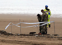 "Pictured: Bomb experts assess at Cefn Sidan beach, near Pembrey west Wales, UK. Saturday 21 May 2016<br /> Re: A suspected bomb washed up on a Welsh beach has been detonated a bomb disposal unit after a walker came across it at Cefn Sidan beach, west Wales.<br /> After the discovery, the beach, aprt of Pembrey Country Park in Carmarthenshire , was cordoned off.<br /> The device was subsequently detonated.<br /> A spokesman for HM Coastguard Swansea said: ""The bomb disposal team is on the scene dealing with the object and it has just been detonated.""<br /> ""We will now be clearing up the debris and making sure the beach is clean and safe."""