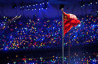 Aug. 8, 2008; Beijing, CHINA; The China flag flies during the opening ceremonies for the 2008 Beijing Olympic Games at the National Stadium. Mandatory Credit: Mark J. Rebilas-