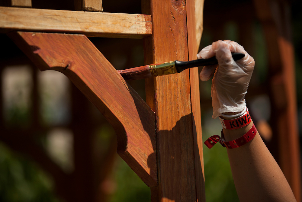 "A member applies wood stain to a gazebo during ""Circle the City with Service,"" the Kiwanis Circle K International's 2015 Large Scale Service Project, on Wednesday, June 24, 2015, in Indianapolis. (Photo by James Brosher)"