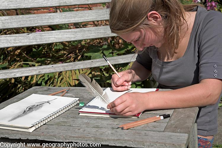 Model released image of teenage girl doing art