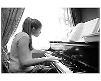 2006 File photo,Montreal (QC) CANADA..Marika Bournaki, .15 year old Montreal Pianist, currently studying in New York, seen preacticing in her Montreal home..Photo : (c) 2006 Pierre Roussel