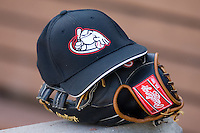 A Salem Avalanche batting practice hat sits atop a Rawlings glove in the visitors dugout at Ernie Shore Field in Winston-Salem, NC, Saturday, May 10, 2008.