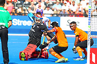 Malaysian defenders are unable to prevent England's Mark Gleghorne from scoring England's 5th goal during the Hockey World League Semi-Final Pool A match between England and Malaysia at the Olympic Park, London, England on 17 June 2017. Photo by Steve McCarthy.