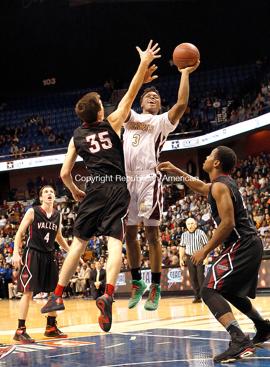 Uncasville, CT- 22 March 2015-032215CM28- Sacred Heart's Mustapha Heron shoots against Valley Regional's Hunter Linfesty during their Class S state championship game at Mohegan Sun Arena in Uncasville on Sunday. The Hearts won, 71-46.    Christopher Massa Republican-American