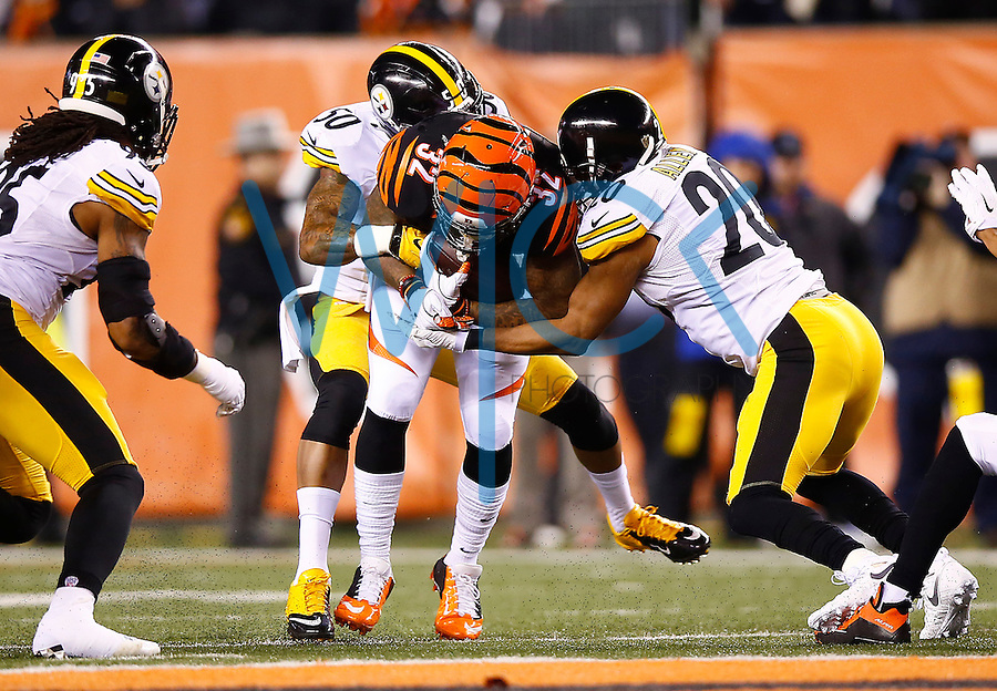 Jeremy Hill #32 of the Cincinnati Bengals is tackled by Ryan Shazier #50 and Will Allen #20 of the Pittsburgh Steelers during the Wild Card playoff game at Paul Brown Stadium on January 9, 2016 in Cincinnati, Ohio. (Photo by Jared Wickerham/DKPittsburghSports)