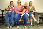 (L-r) Rebecca Bird, 41, with her future wife, Sandra Quandt, 48, and their witness, Rebecca's sister, Jamie Lee (far right), 28, and niece, Shelbie Stevens (in Sandra's lap), 3, all from Davenport, Iowa, wait while Rebecca and Sandra wait for a marriage license at the Scott County Recorder's Office the first day same sex weddings are legal across Iowa in Davenport, Iowa on April 27, 2009.