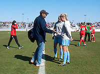 North Carolina chief assistant coach Bill Palladino talks to Hana Gardner and Katie Bowen at halftime at the Maryland SportsPlex in Boyds, MD.  The Washington Spirit defeated the North Carolina Tar Heels in a preseason exhibition, 2-0.