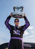 Sep 3, 2017; Clermont, IN, USA; NHRA funny car driver Jack Beckman celebrates after winning the Traxxas Shootout specialty race during qualifying for the US Nationals at Lucas Oil Raceway. Mandatory Credit: Mark J. Rebilas-USA TODAY Sports