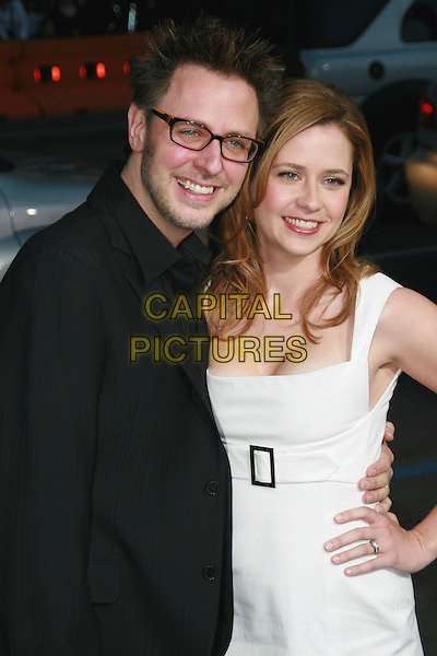"JAMES GUNN & JENNA FISCHER .""Blades of Glory"" Los Angeles Premiere held at Grauman's Chinese Theatre, Hollywood, California, USA..March 28th, 2007.half length black jacket white dress hand on hip glasses.CAP/ADM/CH.©Charles Harris/AdMedia/Capital Pictures"