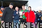 Beale captain James McMahon is presented with the cup  at the Bernard O'Callaghan Memorial Senior Football Championship final last Saturday Beale V Listowel Emmets Pictured Billy Enright (Chairman of North Kerry ), Greg Ryan James McMahon and Ooagh O'Connor