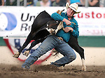 Tanner Milan competes in the steer wrestling event at the Reno Rodeo in Reno, Nev. on Friday, June 19, 2015.<br /> Photo by Cathleen Allison/Nevada Photo Source